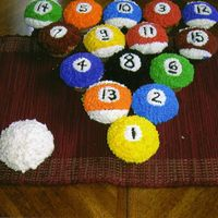 Pool Balls I made these for my brother and my nephew who are huge pool players. They are done in all buttercream.