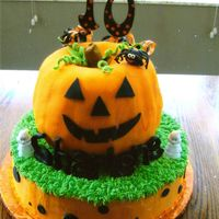 Pumpkin Cake Bottom cake is covered in buttercream with fondant accents. The pumpkin is two bundt cakes put together covered in fondant.