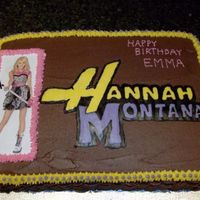 Hannah Montana Chocolate cake with chocolate frosting. Hannah is a laminated picture placed on the cake