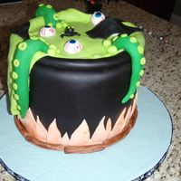 Witch's Cauldron Witch's cauldron, WASC with Cookie dough filling, buttercream crumb and fondant iced. All decorations are fondant.