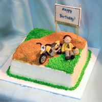 Moto X Cake WASC cake with custard filling and vanilla buttercream. Gumpaste figure and motorbike. That bike gave me a world of trouble! Never again!