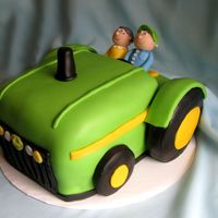 John Deere Cake White Almond Sour Cream cake with vanilla buttercream and fondant. Gumpaste figures.