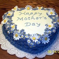 Mother's Day Cake I made this cake for my mom, she loved it and so did everyone else. It was white cake with kahlua raspberry cream filling (from this site...