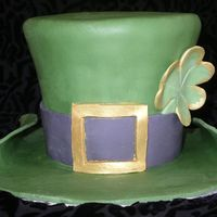 "St. Patrick's Hat First time trying to make a hat. I had a lot of fun with the cake. 3 layers of 6"" round carved into hat shape. Pound cake with lemon..."