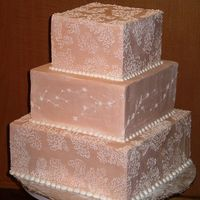 Square Wedding Cake   Just a practice cake, I needed to practice frosting square cakes. Those corners were a pain!
