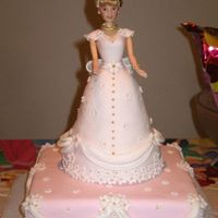 Doll Cake   I posted the sugar doll photos last week. Here is the doll on the actual cake.