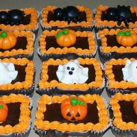Individual Halloween Brownies These are some individual brownies that a customer requested. They are toped with a chocolate glaze and halloween figures that I made out...