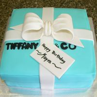 Tiffany & Co. Box This is a 8 in cake covered and decorated with fondant. The bow is a 50/50 mix of gum paste and fondant.