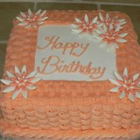 Basket Weave This is a 9in square cake. Buttercream frosting with fondant flowers.