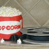 Movie Night I used 6 inch cakes and covered with fondant for the popcorn bucket. For the film I used a six inch cake and used gumpaste for the top, and...