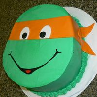 Ninja Turtle I cut the shape out and used whipped icing and fondant accents.