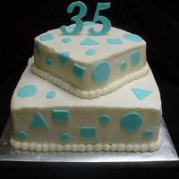 "35Th Anniversary Buttercream icing, fondant shapes & gumpast ""35"" on top"