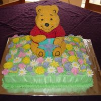 "Pooh 2Nd Birthday Cake  I made this cake for my daughter's birthday. I got all of the flowers on and forgot to add the ""2"" candle! We squeezed it in..."