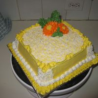 Yellow Buttercream, White Lace And Orange Buttercream Daisies