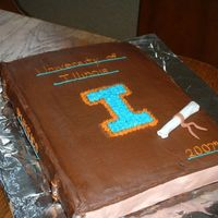 Book Graduation Cake  I did this one for my younger brother's graduation. It's shaped to look like a physics book (rolled out tootsie rolls frosted...