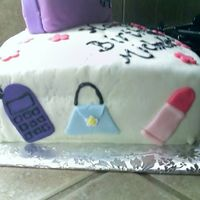 Side View Of My First Cake   Purse is a yellow cake with Strawberry filling- bottom is chocolate w/chocolate filling- all covered with MMF