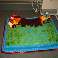 Elmo  I made this for my son for his 2nd birthday. The dirt is just made of crushed chocolate cake, and the toys were just toys that my son had...