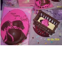 "Tummy 2 Tummy ""Mom-to-be is half sportsball and 2 cupcakes on 13 1/2 X 9 7/8 ovalAll Fondant. Crib is Chocolate many thanks to my DH for help with..."
