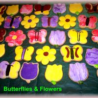 Butterflies__Flowers.jpg simple butterflies and flowers done last minute for my daughters b'day at shcool. Cookies are covered in fondant. TFL
