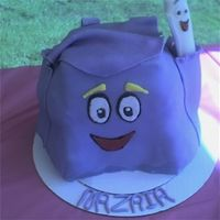 "Backpack From Dora The Explorer Yellow cake with BC. To save time, I just baked one 14"" square , cut it into fourths and stacked. Used Rice krispies to fill out sides..."