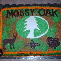 Mossy Oak Cake  This is an 11x15 buttercream cake. The letters and the animals are made out of chocolate. I made this cake for a little boys 9th birthday...