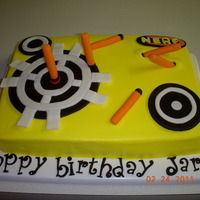 "Nerf Dart Cake client 's son, saw this on cake walk, i think. buttercream iced. chocolate clay mixed with a little fondant(carrie bigger""s)..."