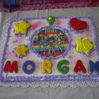 Bratz This cake was decorated for my daughter's birthday this weekend. She loves Bratz. Decorated with butter cream. Also added some cookies...