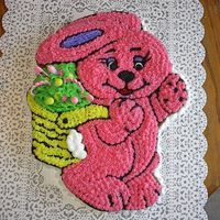 Special Bunny Baby Shower. Special Bunny Cake pan made with butter cream, mouth is red gel. The basket is holding baby bracelets, bottles and saftey pins. She had her...