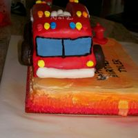 Front View Of Firetruck Front view of my first attempt at 3-D cake for my nephew's 2nd birthday!