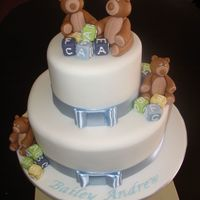 Teddy Bears Two tiered cake covered in fondant with sugar bears and blocks