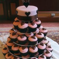 Wedding Cake Chocolate and vanilla cupcakes with mud cake on top tier covered in fondant and hearts.