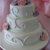Wedding Cake Three tier cake covered in fondant and gumpaste roses
