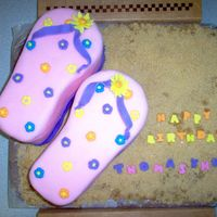 "Birthday Beach Flip Flop This is a cream cheese poundcake with buttercream crumb coating. MMF fondant and brown sugar ""sand."" I used 2 loaf pans to make..."