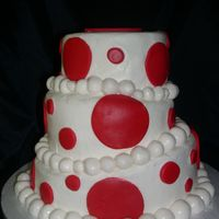 Red And White Cake My first whimsical cake. Buttercream with fondant circles and balls.