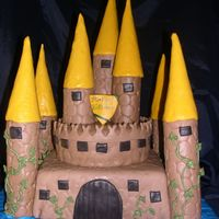 Castle Cake Yellow cake, Chocolate MMF, Ice Cream Cones covered in MMF. First castle cake. Made for the SAFE kids birthday