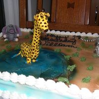 Zoo Animals Giraffe, Elephant and Zebra all fondant. I had fun doing this one. Regret the colors weren't more pastel, I was thinking too realistic...