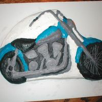 Grooms Cake Harley  This is a white cake with bc frosting. This is what his harley looks like. First grooms cake and first motorcycle. I used wilton pan. He...