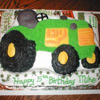 John Deer Tractor   I made this for a little boy who loves john deer tractors. It is yellow cake with bc frosting. This was fun to make.