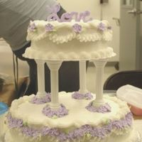 Course 3 Final Cake Iced in buttercream with buttercream piping and royal flowers.