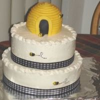 "Cc.jpg 8"" and 10"" chocolate cakes with whipped chocolate filling. Topped with a beehive covered in fondant...bees also made of fondant..."