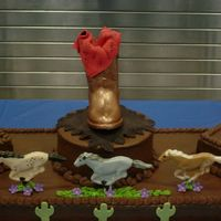 "Boot 48"" long cake - This was done for a western band party. Chocolate boot and horses. Fondant bandana, sunflowers and cactus"