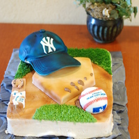 Baseball Grooms Cake  Made for my cousins wedding. Hat is choc cake, plate is marble, ball is rice krispie treats, and the main cake is white frosted in...