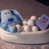 Blue And Slippery Blue's Clues characters in a gum ball filled fondant tub. Tub is dusted with pearl dust. All made with fondant!!!