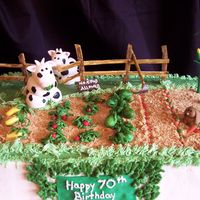 Cows In The Garden!! Fondant Cows, rabbit, veggies! Gumpaste fence, hoe and signs...this was a lot of fun to make and the client just loved it! I love this kind...