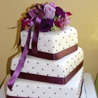 Ann's Wedding Cake Had a lot of trouble with the cake crumbling, but in the end, it turned out ok. Aubergine (eggplant) ribbon and dots. TFL