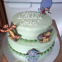 Winnie The Pooh Buttercream icing with melted chocolate. Inspiration came from Marissa's original.