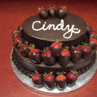 Cindy's Berry Goo Birthday Co-worker's birthday cake. Dark chocolate cake, dark chocolate frosting, and milk chocolate dipped strawberries. Those were all firsts...