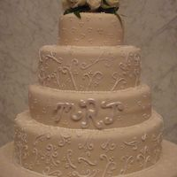 Winter Wedding 4 teir ivory fondant wedding cake. Decorated with piped scroll work.when cut into all you saw was the beautiful red velvet cake.