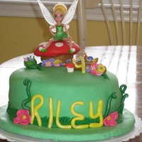 Tinkerbell Tinkerbell on mushroom with flowers. I made this cake for my daughter's 4th birthday. Marshmallow fondant for everything except tink...