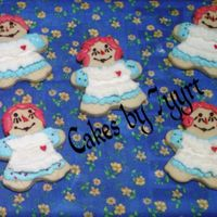 Raggedy Ann Clothed In A Ruffled Apron With A Tiny Candy Heart Raggedy Anne doll in buttercream clothing, Melissa's NFSC recipe.